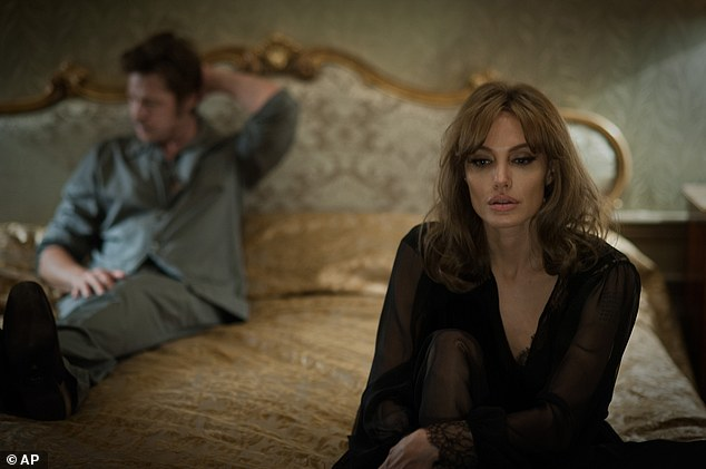 """This photo provided by Universal Pictures shows, Brad Pitt, left, as Roland and Angelina Jolie Pitt as Vanessa in a scene from the film """"By the Sea,"""" directed by Jolie Pitt. The movie opens in U.S. theaters on Nov. 13, 2015. (Merrick Morton/Universal Pictures via AP)"""